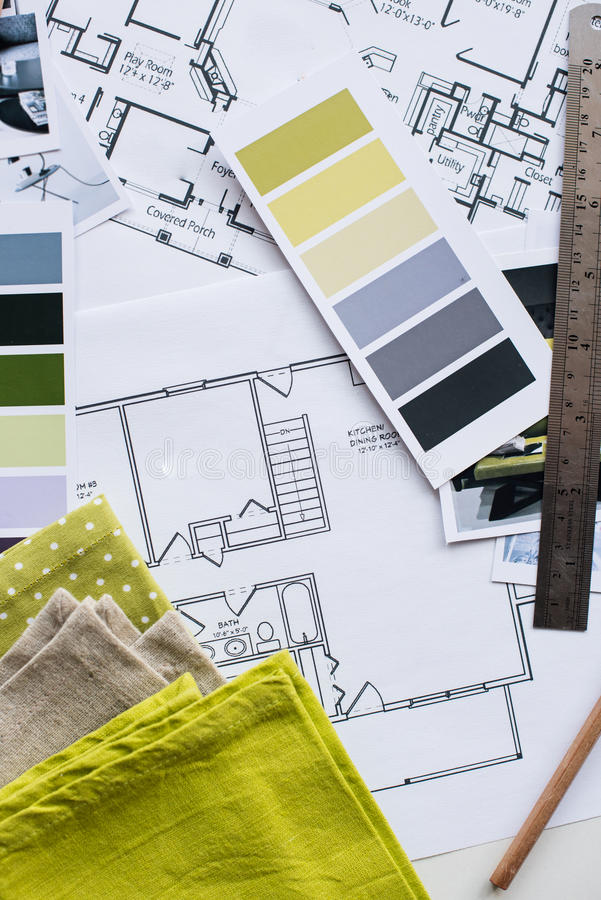 Interior designers working table. Interior designer's working table, an architectural plan of the house, a color palette, furniture and fabric samples in yellow royalty free stock photos