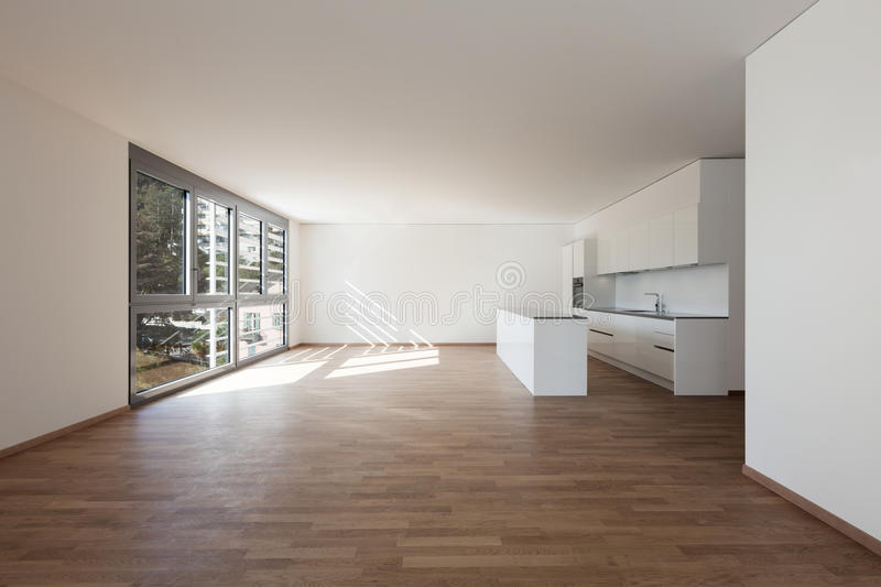 Interior, domestic kitchen. In empty apartment, parquet floor royalty free stock image