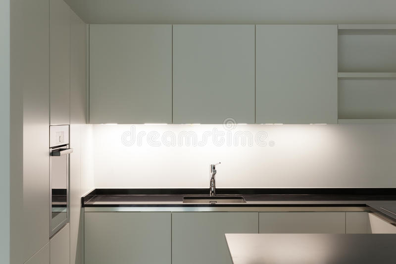 Interior, domestic kitchen. Interior of new apartment, white domestic kitchen royalty free stock images