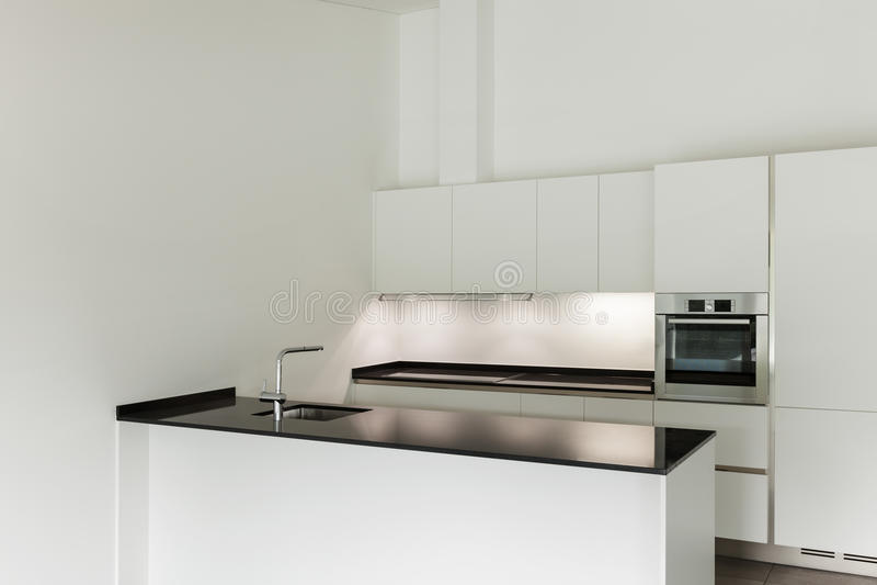 Interior, domestic kitchen. Interior of new apartment, white domestic kitchen stock photography