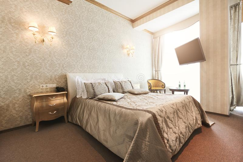 Interior of double bed hotel bedroom royalty free stock images