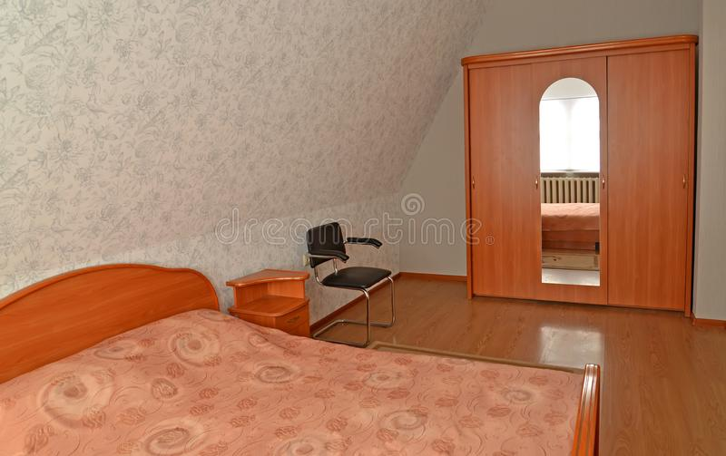 Interior of the double room on the mansard floor.  stock photos