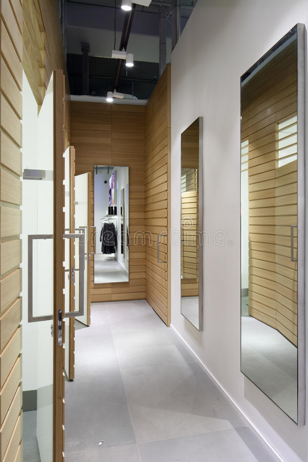Interior of dressing room at cloth store royalty free stock images