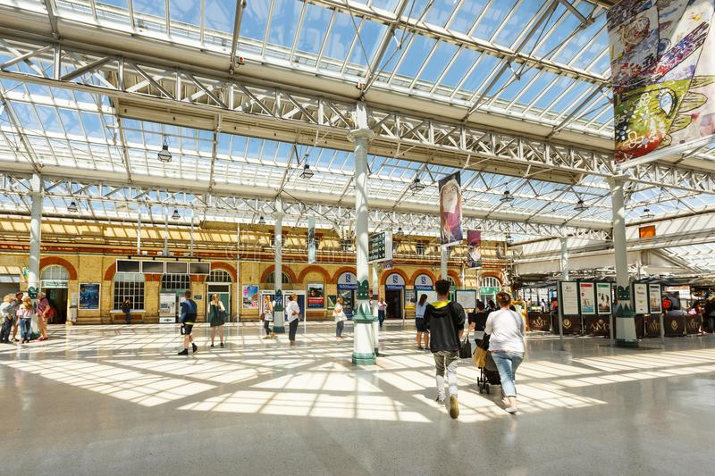 Interior of the Eastbourne train station, United Kingdom. Eastbourne, United Kingdom - AUGUST 1, 2017: interior of the Eastbourne train station in summer sunny stock photos