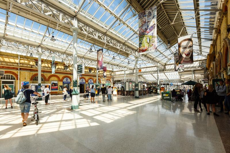 Interior of the Eastbourne train station, United Kingdom. Eastbourne, United Kingdom - AUGUST 1, 2017: interior of the Eastbourne train station in summer sunny stock photo