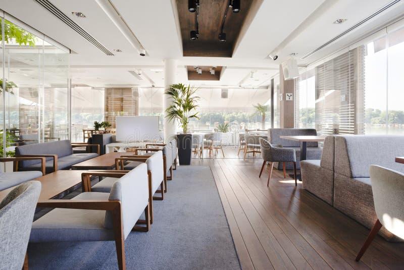 Interior of an elegant riverside cafe.  stock images