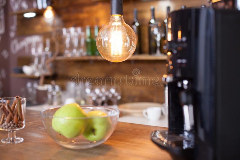 Interior elements of cozy coffee shop with blurred coffee machine in the background royalty free stock image