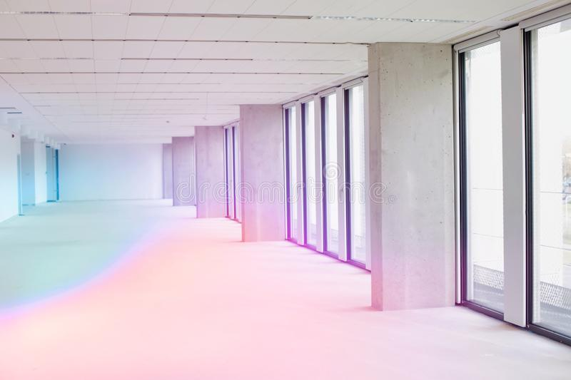 Interior of empty corridor in new office. With lens flare stock image