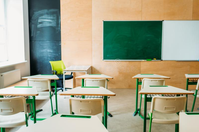 Interior of empty modern classroom with blank chalkboard at school royalty free stock photography