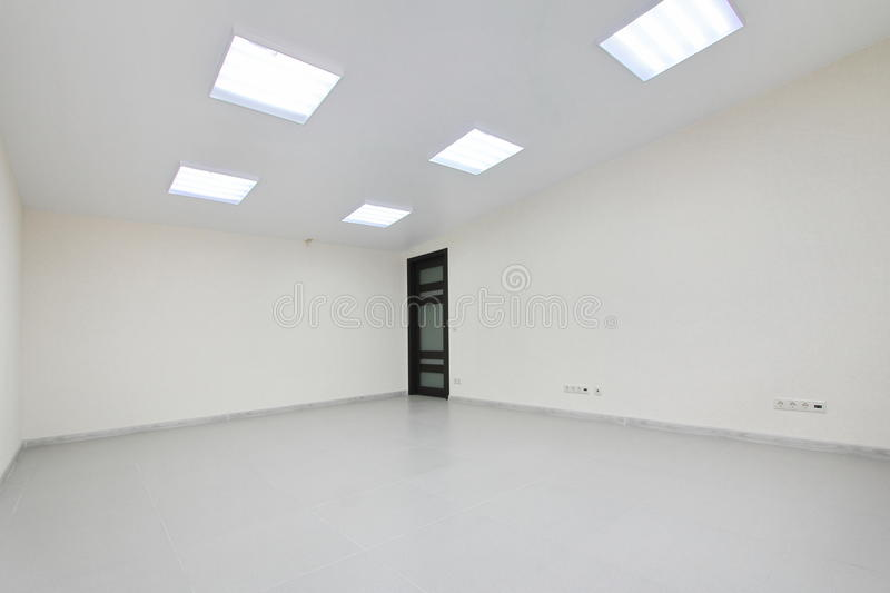 Interior empty office light room with white wallpaper unfurnished in a new building. Interior empty office light room with white wallpaper without furniture in a stock photos