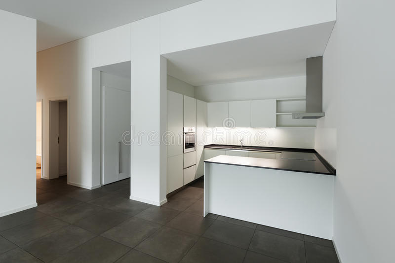 Interior, empty room with domestic kitchen. Interior of new apartment, empty room with domestic kitchen stock photography