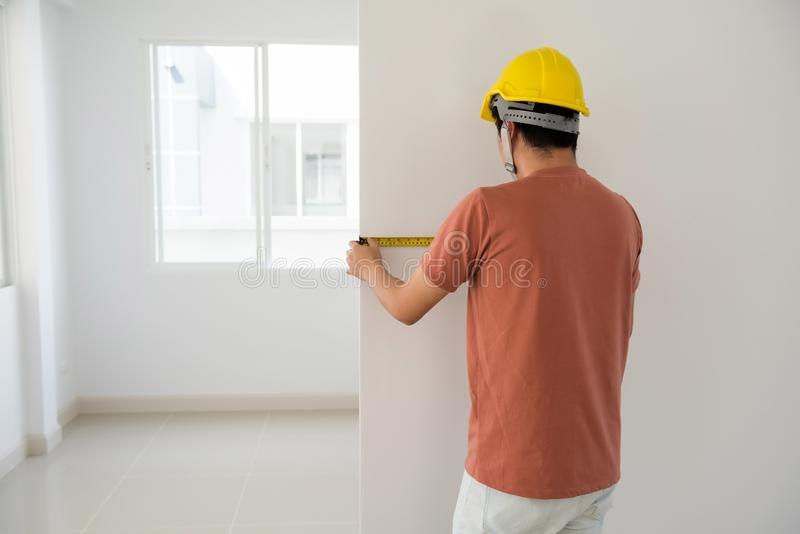 Download Interior Engineer Measure New House Wall Stock Photo - Image of helmet, length: 114058942