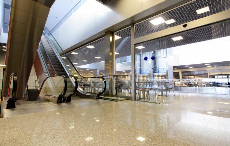 Interior with escalator stock photos