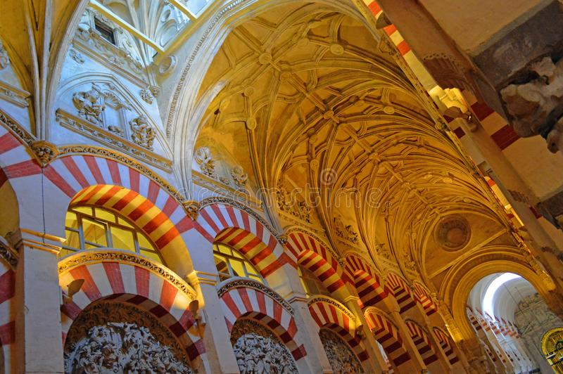 Interior - the famous double archways and low lit vaulted ceiling at the Mezquita Cordoba, Andalucia, Spain. The famous double archways and low lit vaulted stock images