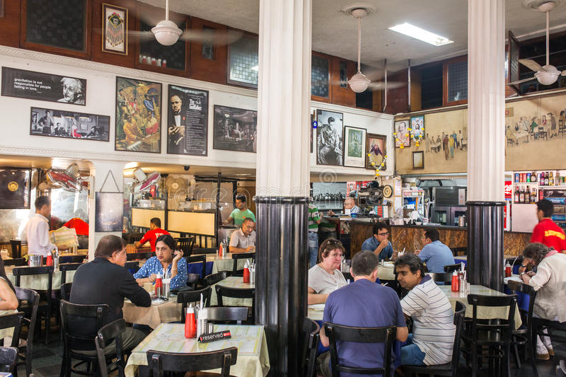 Interior of famous Leopold cafe in Mumbai, India. Mumbai, India - February 27, 2016: Interior of famous Leopold cafe in Mumbai, India royalty free stock images