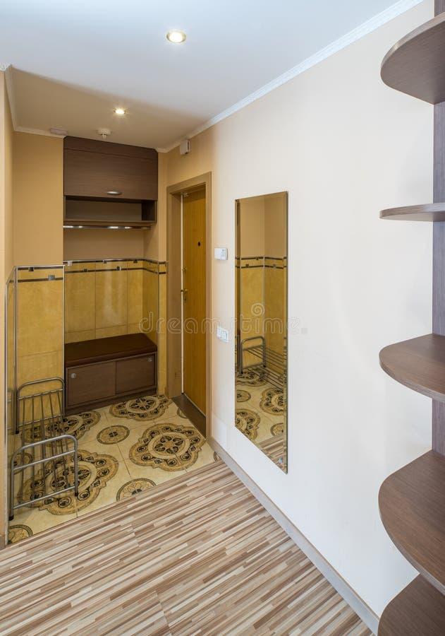Interior of the flat. Warm tones, wooden floor. Hallway furniture. stock photos