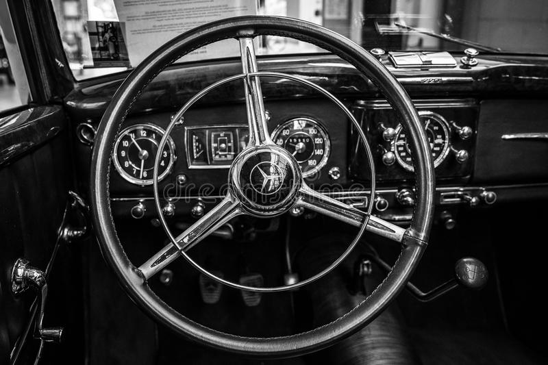 Interior of a full-size luxury car Mercedes-Benz 220 `Cabriolet A` W187, 1951. BERLIN - MAY 06, 2018: Interior of a full-size luxury car Mercedes-Benz 220 ` royalty free stock images