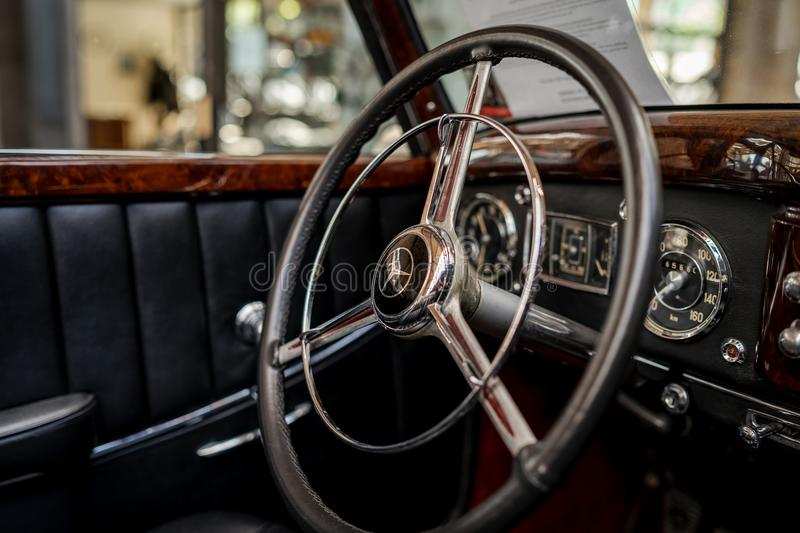 Interior of a full-size luxury car Mercedes-Benz 220 `Cabriolet A` W187, 1951. BERLIN - MAY 06, 2018: Interior of a full-size luxury car Mercedes-Benz 220 ` stock photography