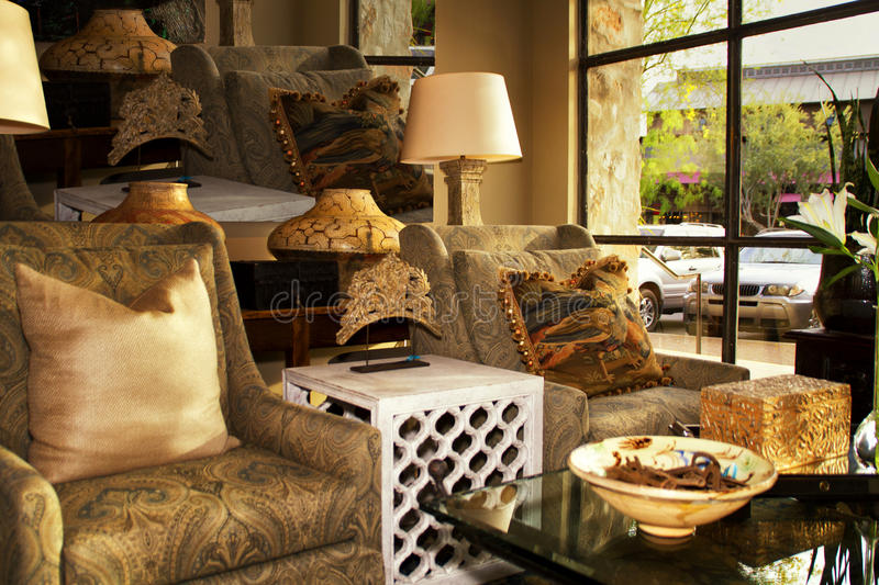 Interior Furnishings Design Boutique Store. Interior design retail store setting with furnishings, lamps, chairs, tables and more royalty free stock image