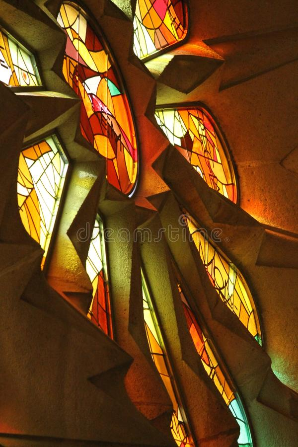 Interior glass window in Gaudi`s Sagrada Familia cathedral in Barcelona, Spain. royalty free stock images