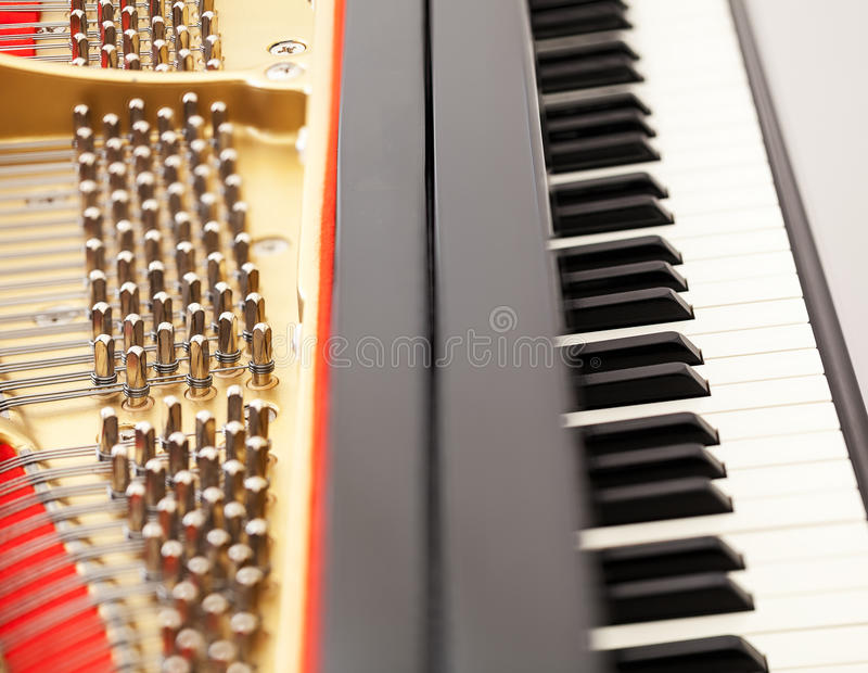 Interior of grand piano with keys stock image