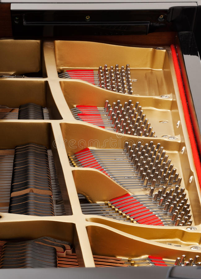 Interior of grand piano with strings stock photos