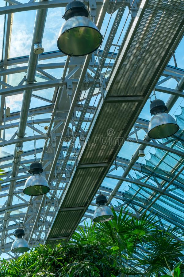 Interior of greenhouse in garden with transparent glass roof. royalty free stock images