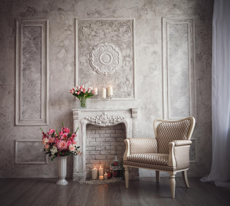 Interior with grey fretwork background, fireplace and flowers.  stock photos