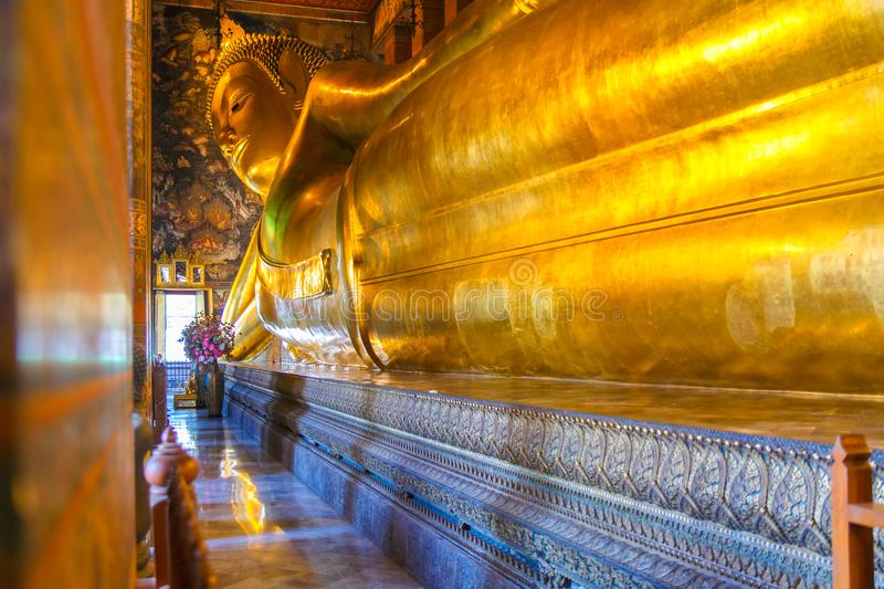Interior of the hall of the reclining Buddha at Wat Pho royalty free stock photos