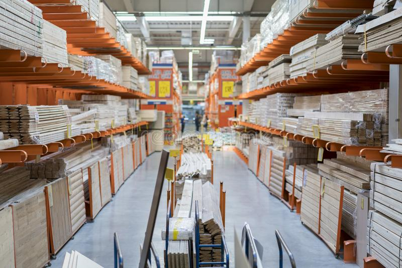 interior of hardware retailer with aisles, shelves, racks of building material insulation floor to ceiling. stock photos