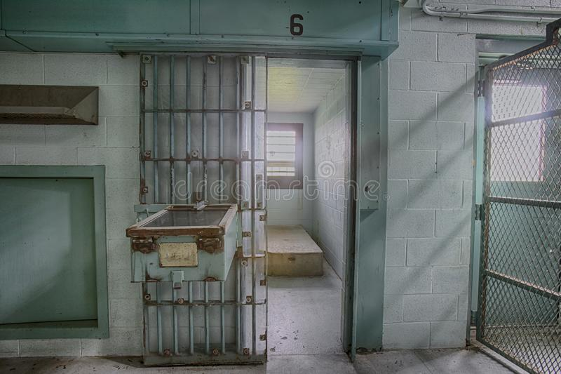Empty high risk solitary confinement cell in abandoned prison stock photography