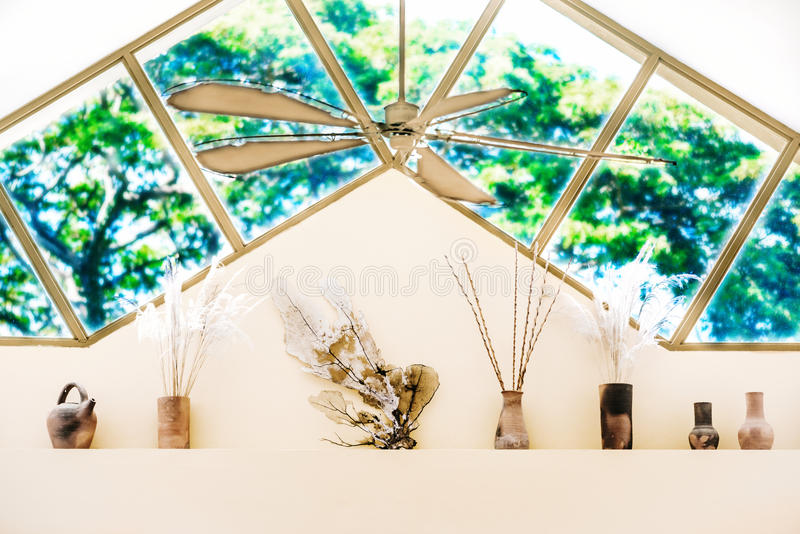 Interior high window design living room high wall decorative objects.  stock photography