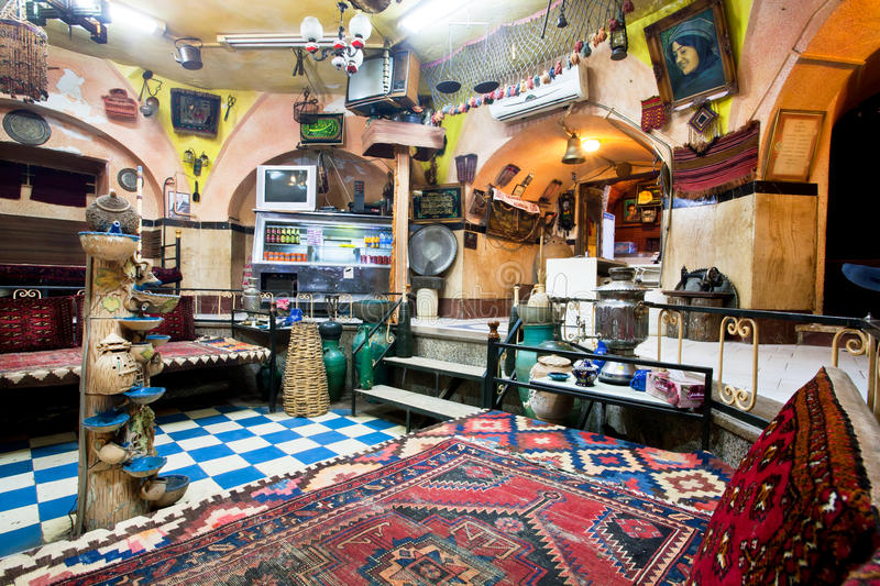 Interior of historical Persian cafe house with old carpets, vintage furniture and arts stock photography