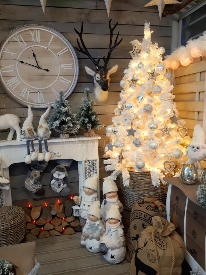Interior of home articles shop with Christmas decorations. Interior of a home articles shop with Christmas items on sale. Seasonal display concept royalty free stock image