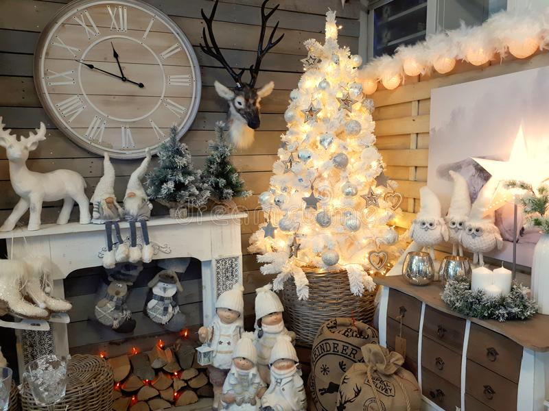 Interior of home articles shop with Christmas decorations. Interior of a home articles shop with Christmas items on sale. Seasonal display concept royalty free stock images