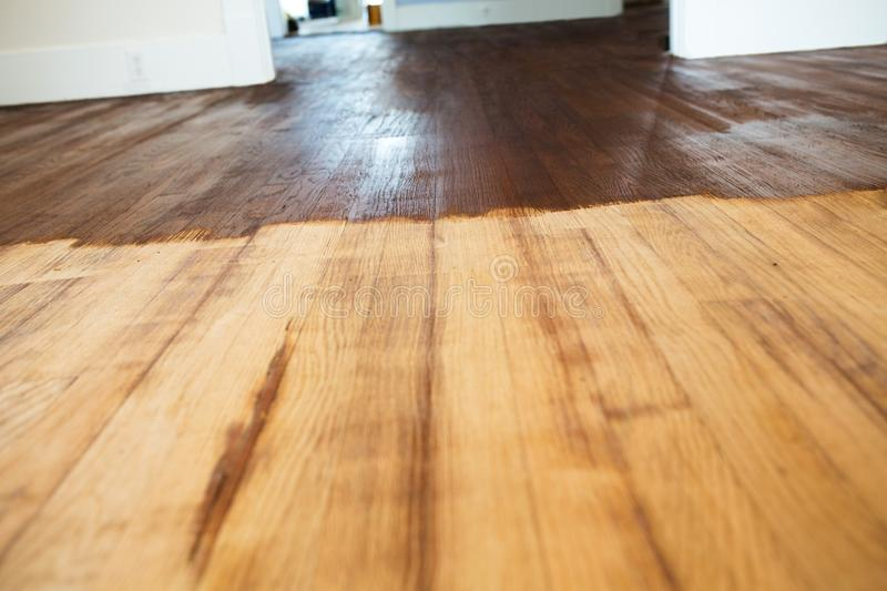 Refinish wood floors. Interior of a home. Contractor refinish wood floors stock images