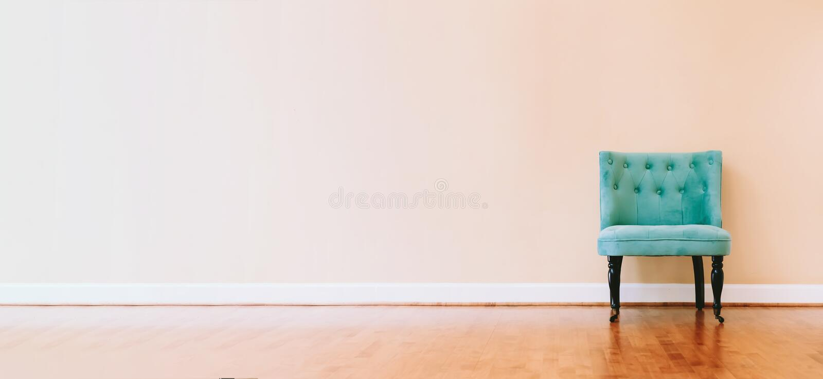 Interior home with turquoise chair. Large luxury interior home with turquoise chair stock image