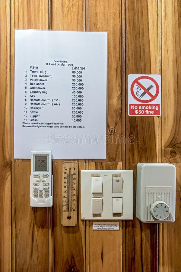 The interior of hotel room. Climate control in the hotel room on the wall. List of items in a hotel room with a quoted price in case of damage or loss, warning royalty free stock photos