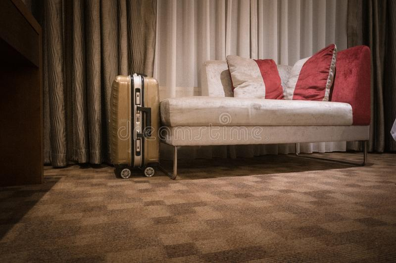 Interior of a hotel room with sofa and luggage. An image of a modern five star hotel master bedroom with a luggage next to sofa.horizonal color format, nobody in royalty free stock photography