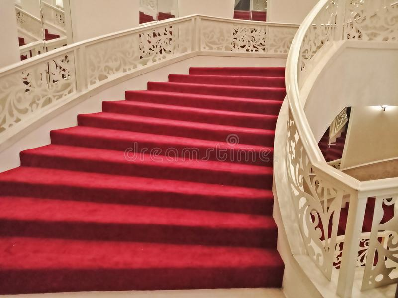 Excellent Interior House With Curved Stair And Red Carpet Stock Photo  LI64