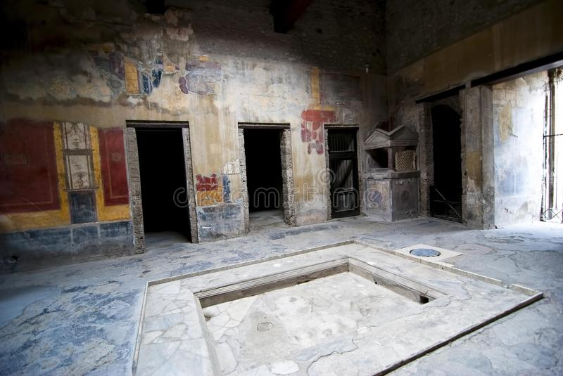 Interior of a house at Pompeii. Interior of a house or Domus at PompeiiInterior of a ancient house in the city Pompeii destroyed by the eruption of Vesuvius in stock photo