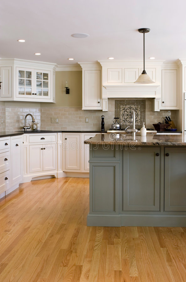Interior Kitchen. Interior modern kitchen with custom cabinets and wood flooring royalty free stock photo
