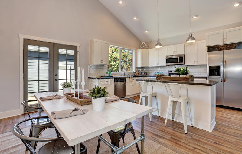 Interior Of Kitchen And Dining Room With High Vaulted ...