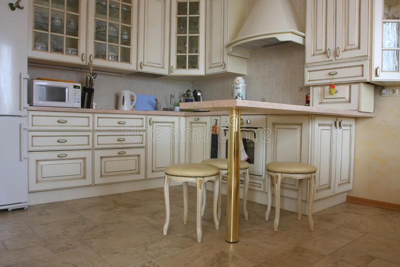 Interior of kitchen with a table and tablewares in royalty free stock photography