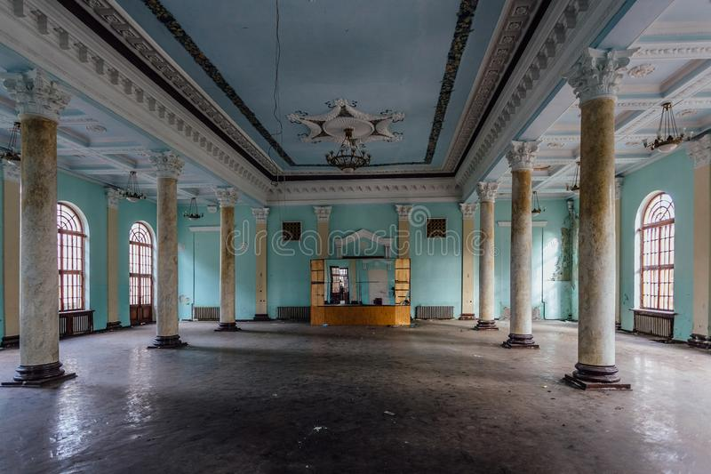 Interior of large column hall with fretwork at abandoned mansion.  royalty free stock photography