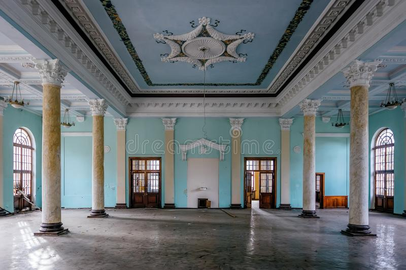 Interior of large column hall with fretwork at abandoned mansion.  stock photography