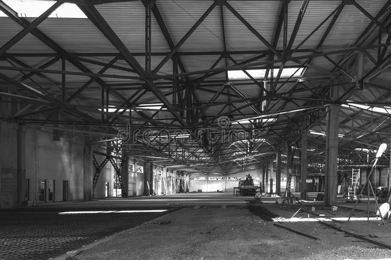The interior of a large industrial building in the process of construction stock photos