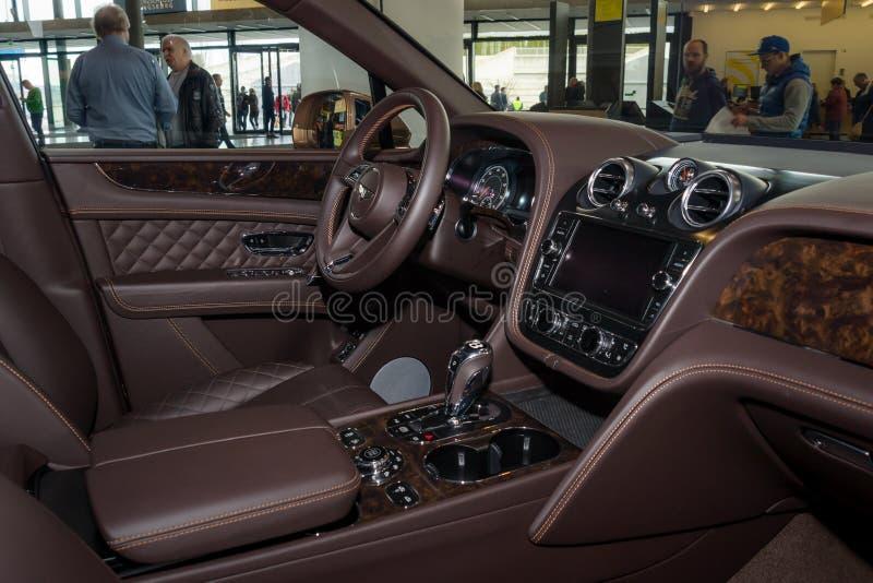 Interior of the large luxury crossover SUV Bentley Bentayga, 2016. STUTTGART, GERMANY - MARCH 04, 2017: Interior of the large luxury crossover SUV Bentley royalty free stock photos