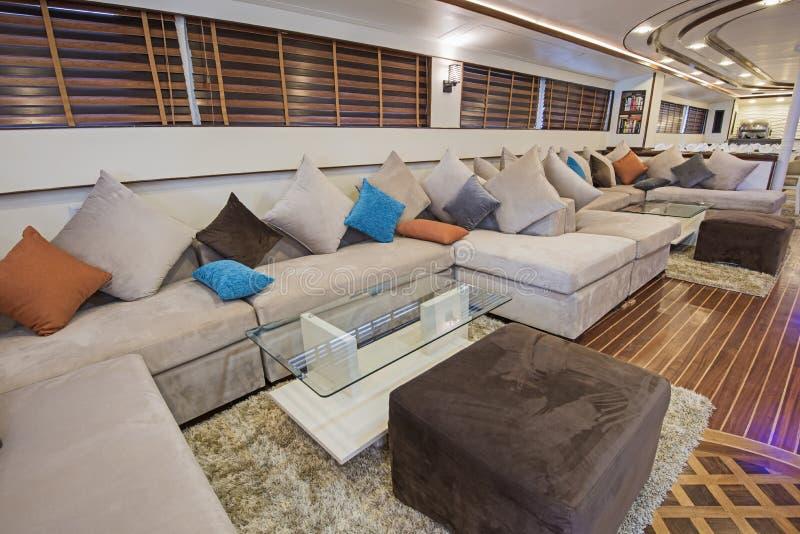 Interior of large salon area of luxury motor yacht stock photos