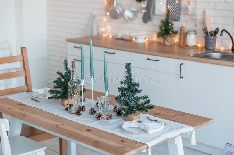 Interior light kitchen with christmas decor and tree.  royalty free stock photography